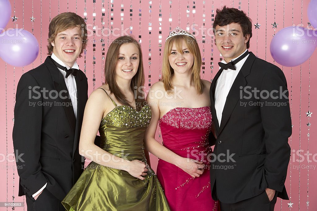 Two Young Couples Dressed For Party stock photo
