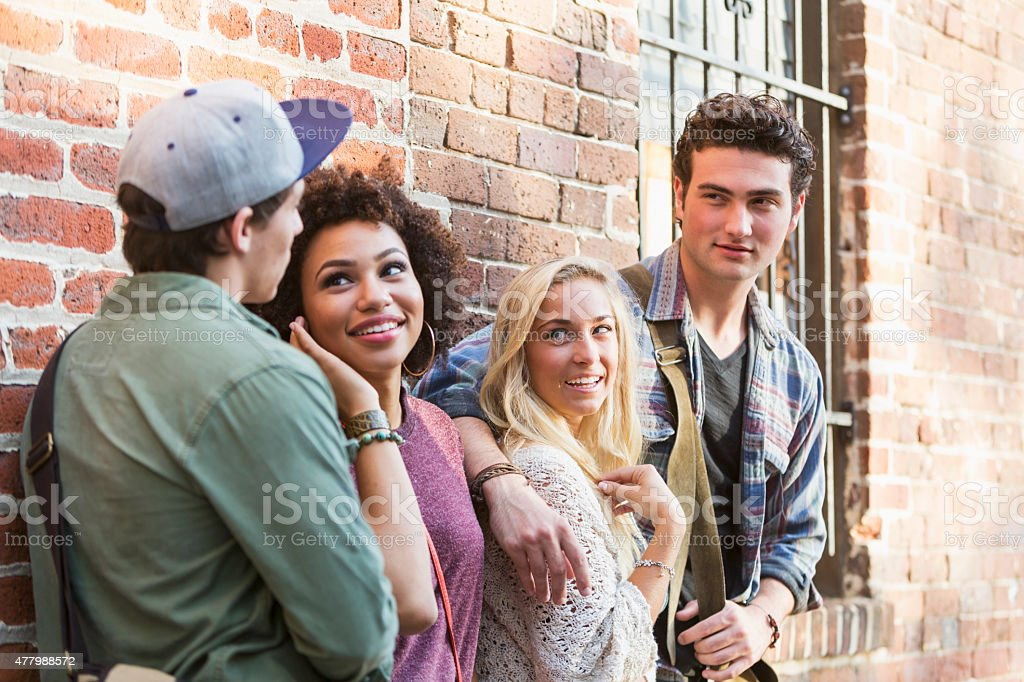 Two young couples hanging out stock photo