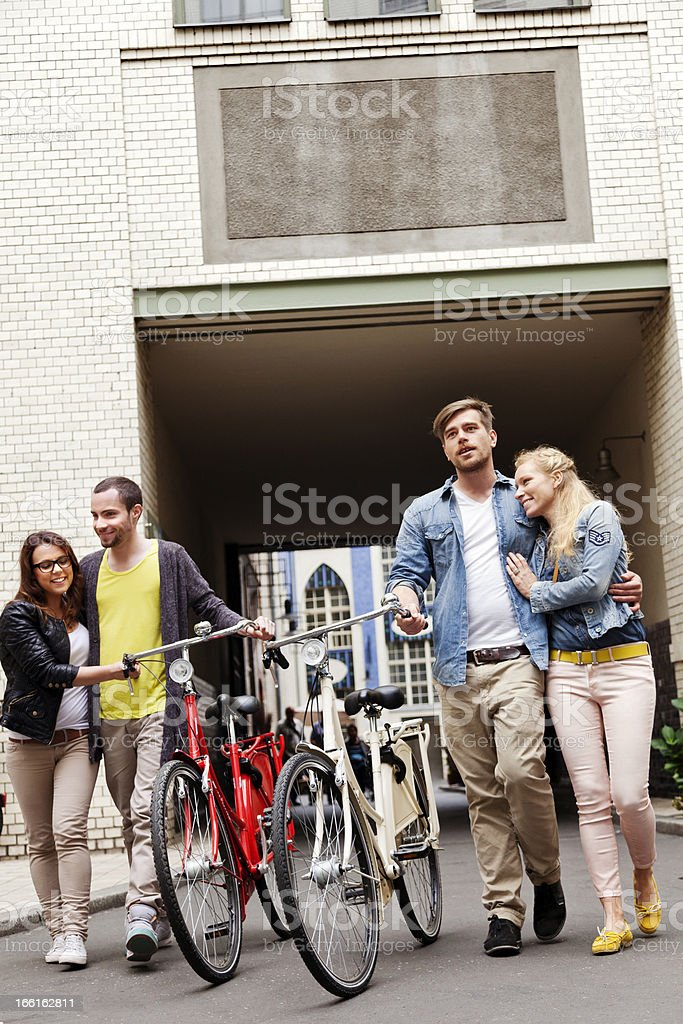 Two Young Couples Leisure Alley Walk royalty-free stock photo