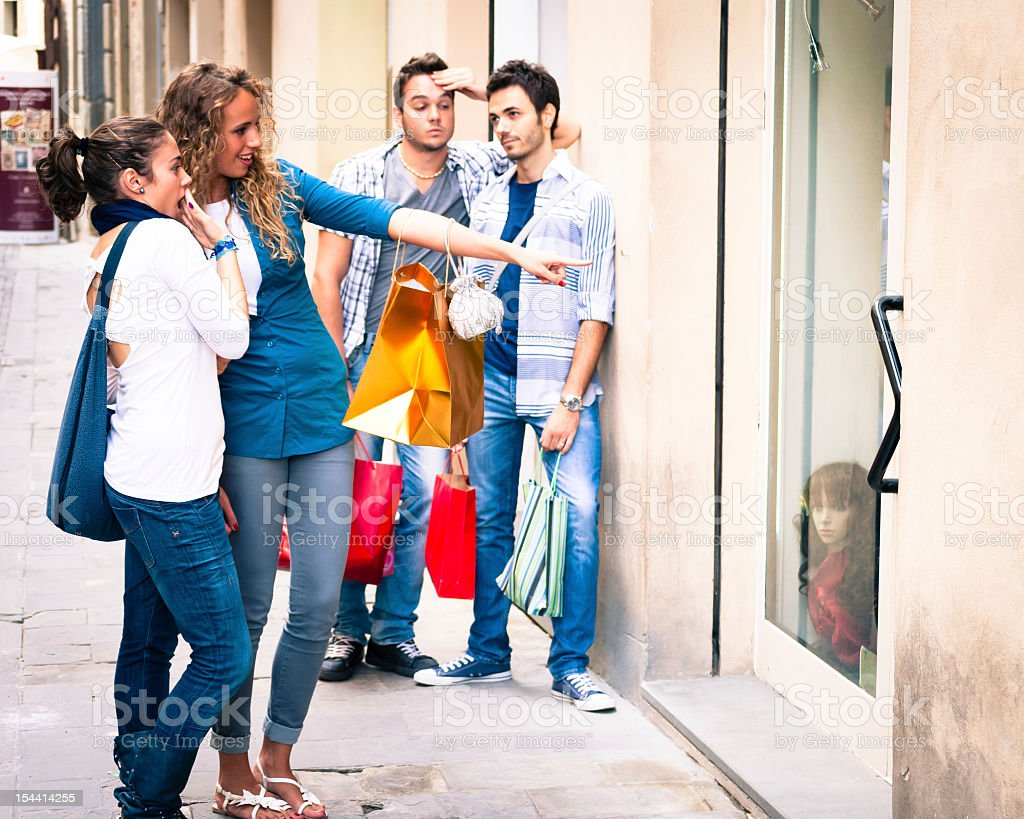 Two young couples making shopping - the guys are bored stock photo