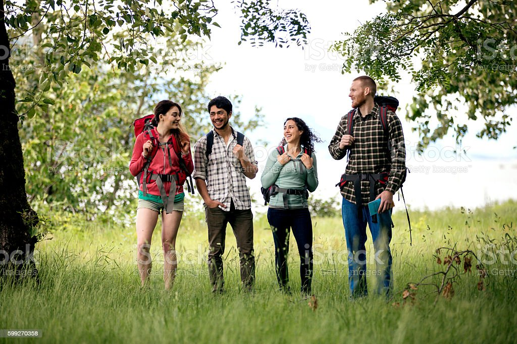 Two young couples talking about their weekend adventure stock photo