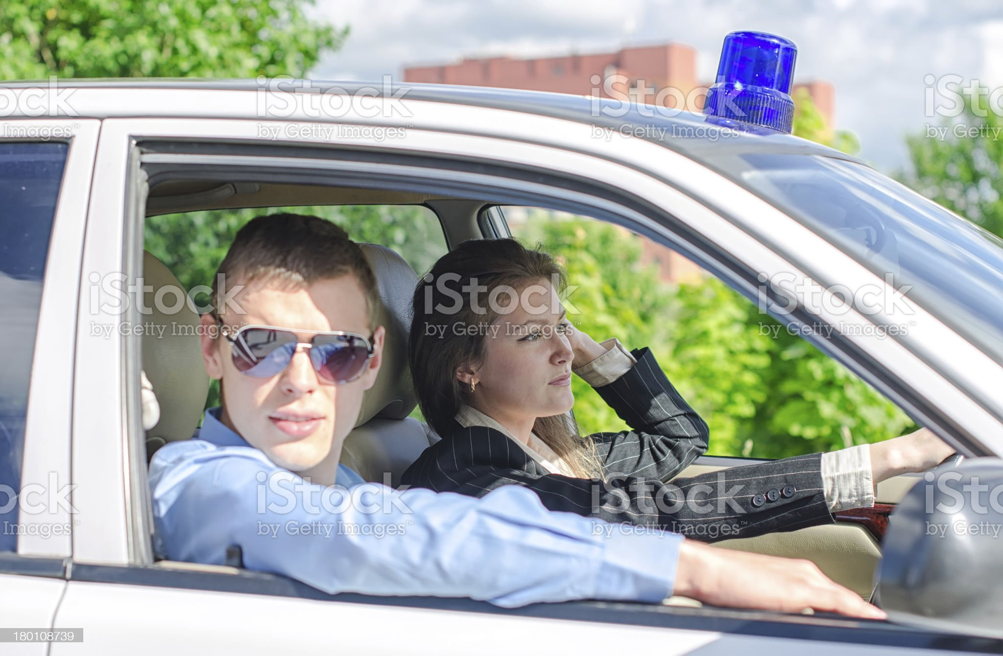 Two young detectives driving to crime scene. royalty-free stock photo