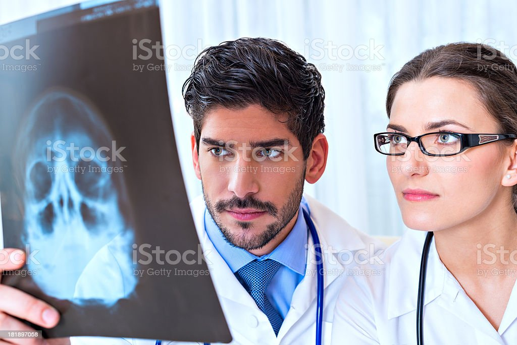 Two young doctor evaluating an X-ray film royalty-free stock photo