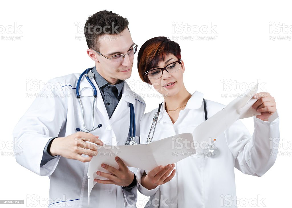Two young doctors discuss the results of the electrocardiogram. stock photo