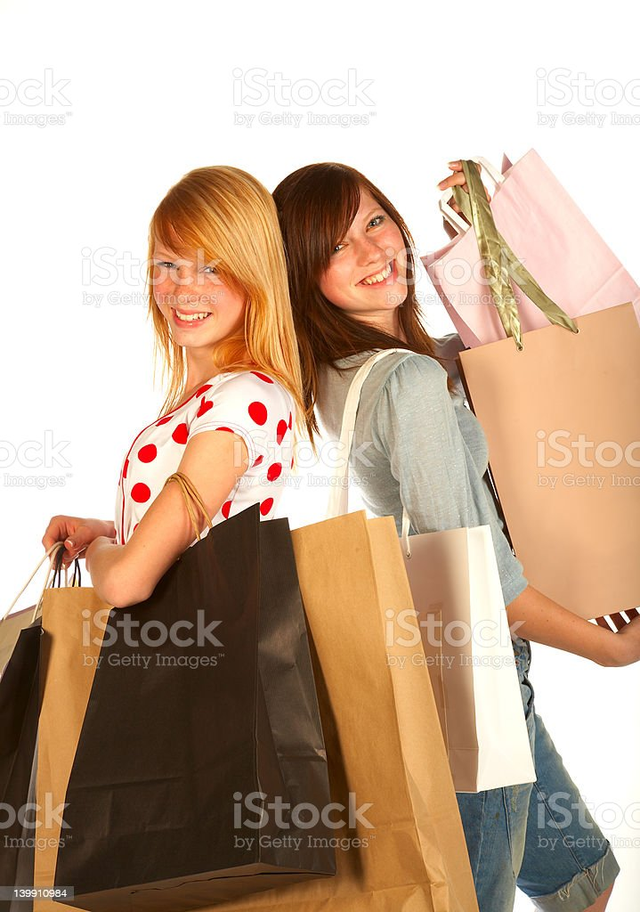 Two young female friends carrying shopping bags royalty-free stock photo