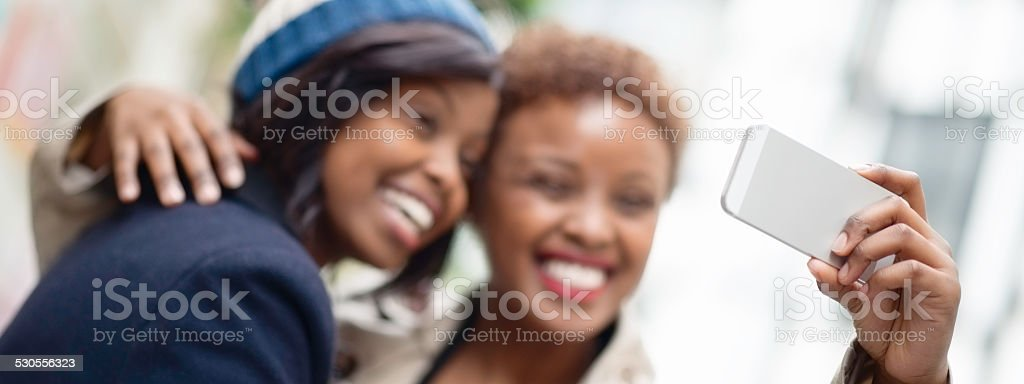 Two Young Female Friends Taking a Selfie stock photo