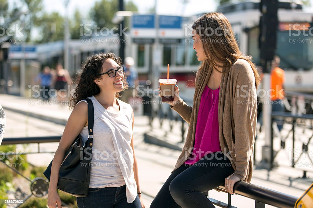Two young female professionals having a fun conversation stock photo