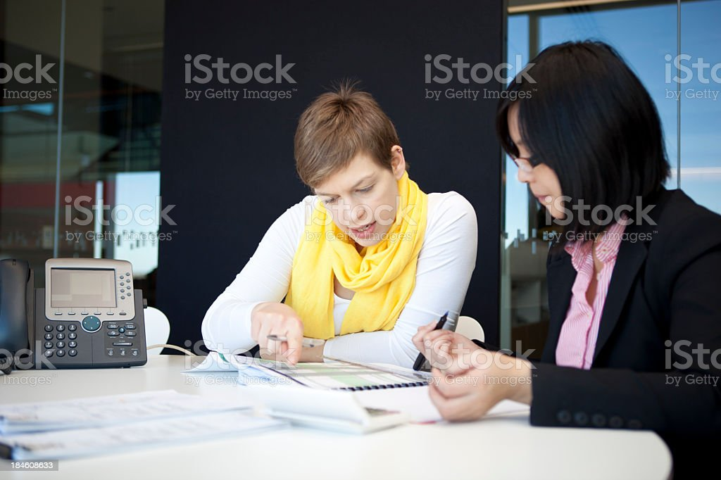 Two young female professionals working royalty-free stock photo