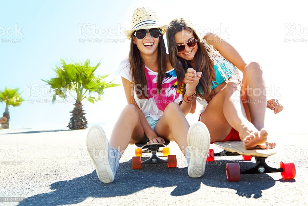 Two young friends hanging out on their longboards royalty-free stock photo