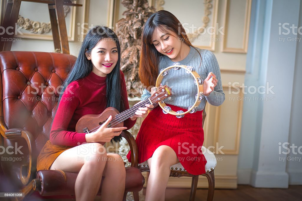 Two young girl friends having fun and smiling stock photo
