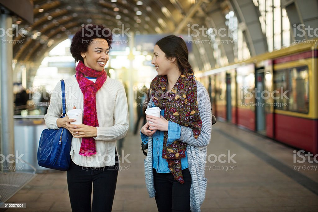 Two young girlfriends on the public transport stock photo