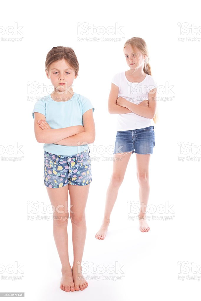 two young girls having a disagreement stock photo