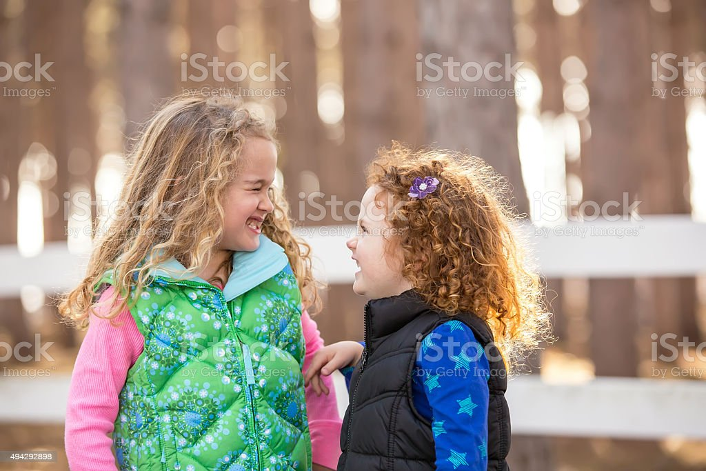Two Young Girls Having Fun Together stock photo