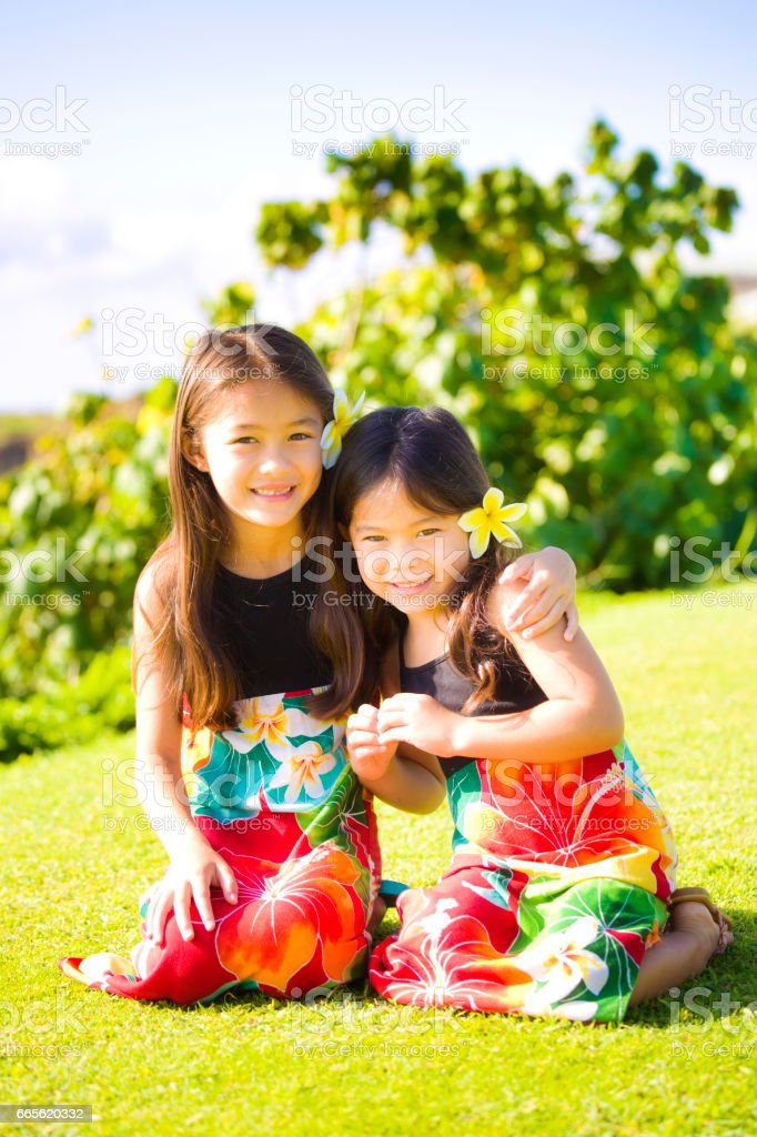 Two Young girls Hawaiian Polynesian Children in Tradition Dresses stock photo