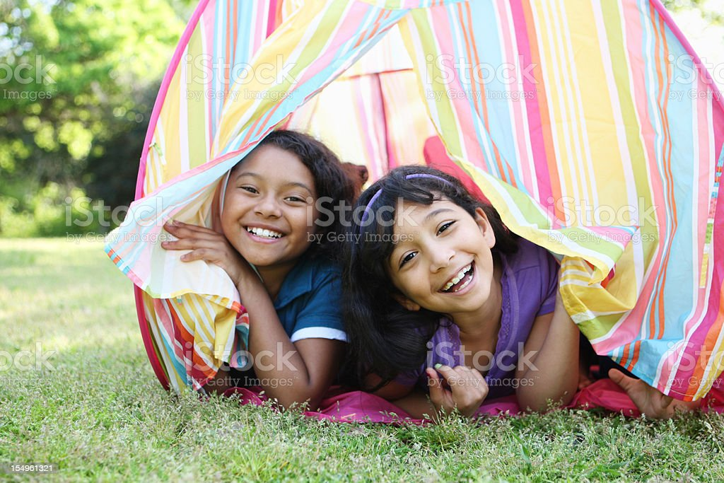 Two young girls in a pastel tent royalty-free stock photo