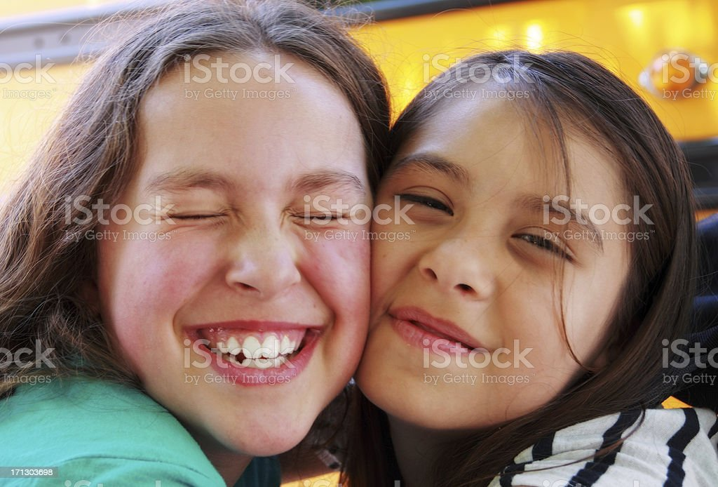 Two young girls in s warm, happy embrace.  stock photo