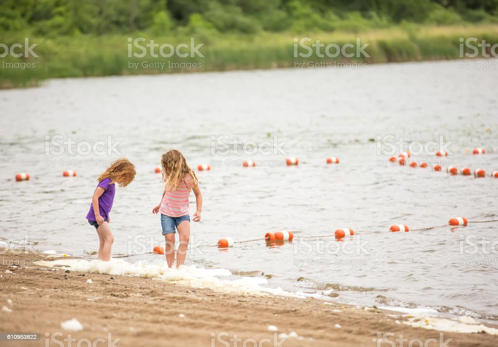 Two Young Girls Playing At Beach stock photo