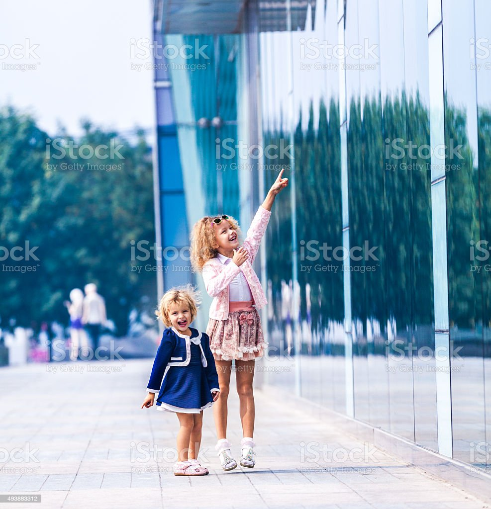 Two young girls posing in full length stock photo