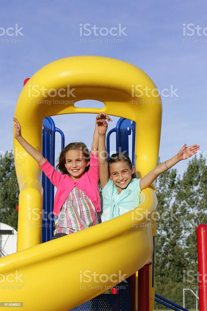 two young girls sliding royalty-free stock photo