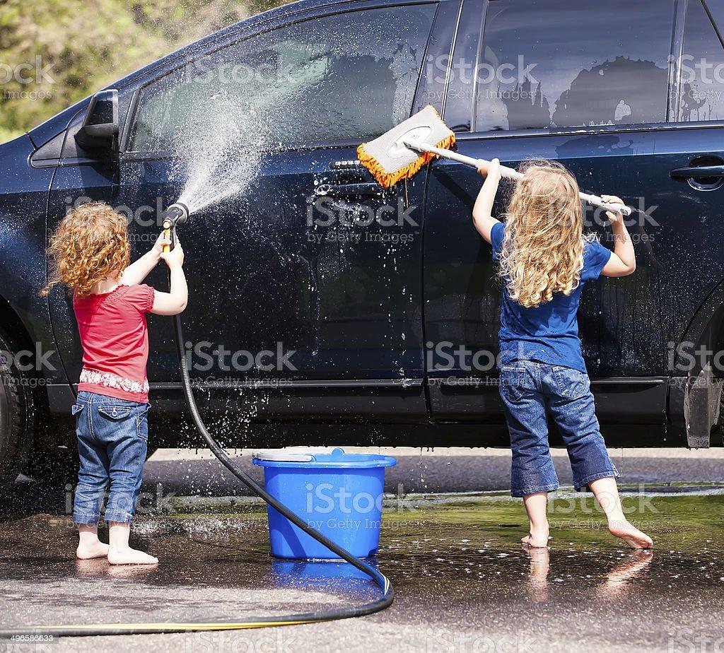 Two Young Girls Washing Car stock photo