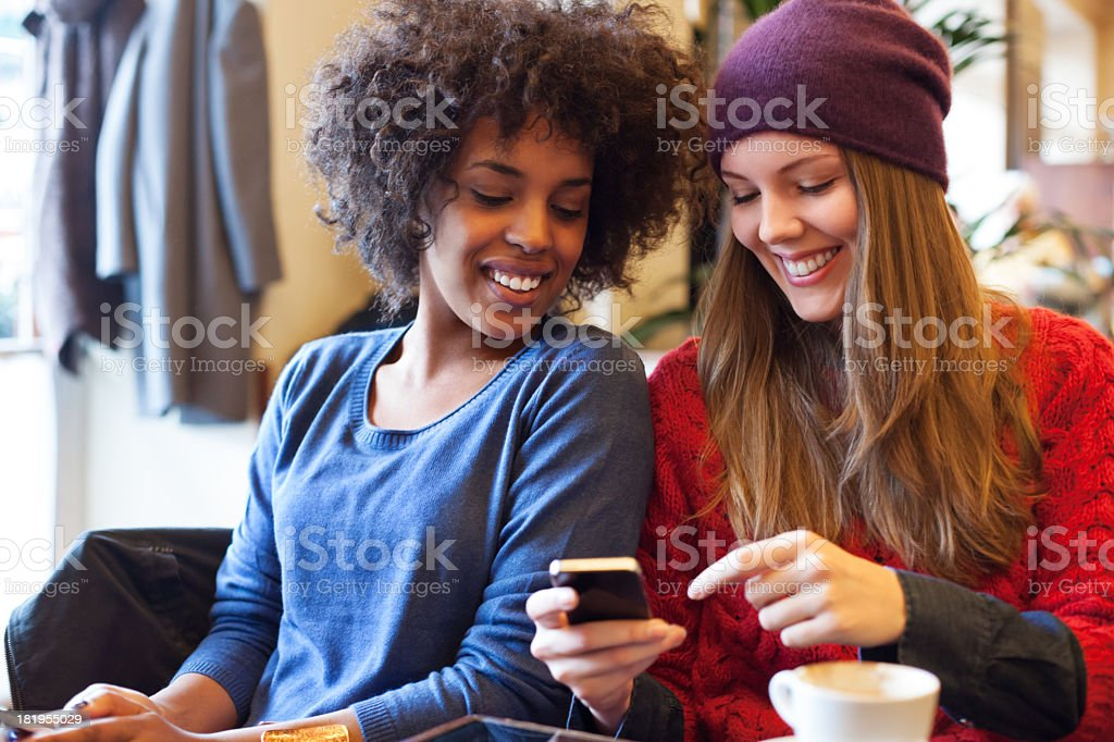 Two young girls with a smartphone royalty-free stock photo