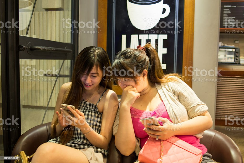 Two young girls with a smartphone stock photo