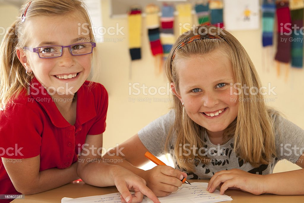 two young girls writing royalty-free stock photo