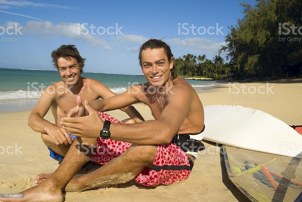 Two young guys on the beach royalty-free stock photo