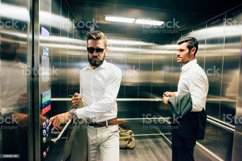 Two young handsome black and blonde hair bearded modern business stock photo