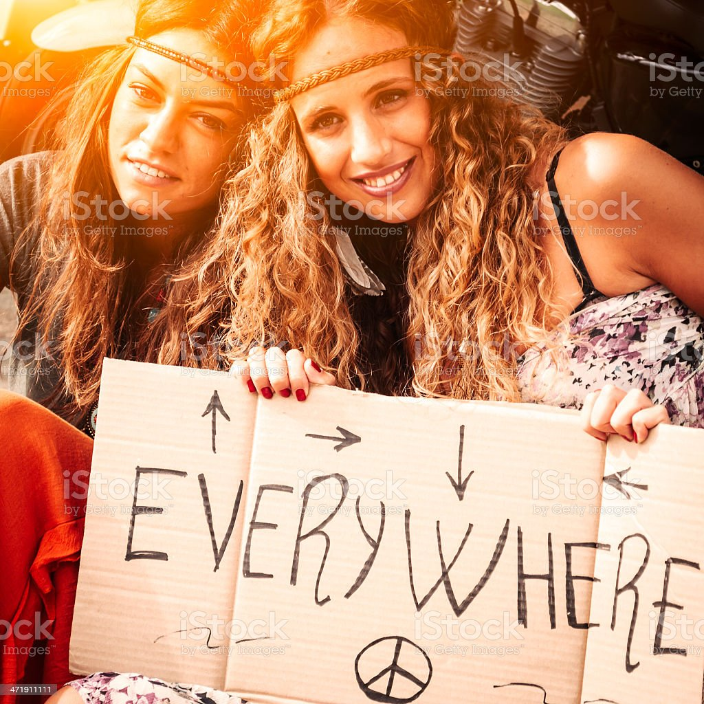 Two Young Hippie Friends Looking For A Ride stock photo