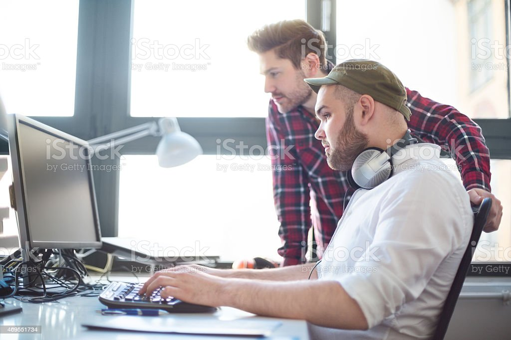 Two young IT professionals together stock photo