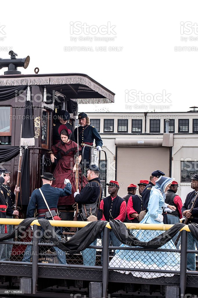 Two Young Ladies Being Escorted From Lincoln's Funeral Car Reenactment stock photo