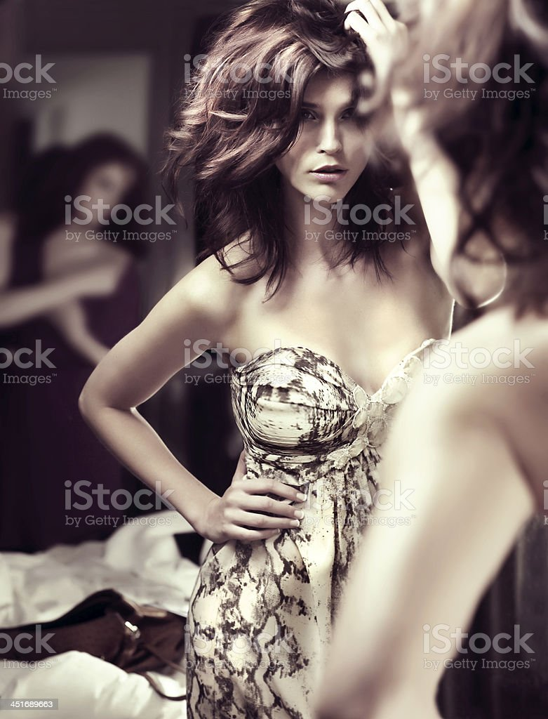 Two young ladies preparing for a night out. stock photo