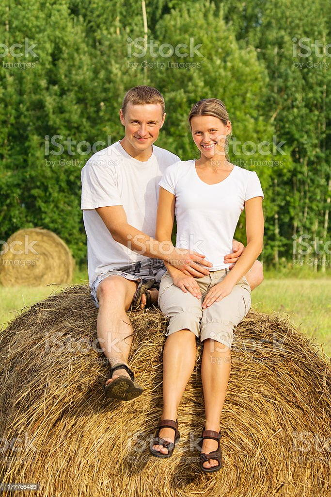 Two young lovers on haystack royalty-free stock photo