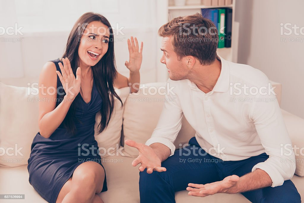 Two young lovers quarreling because of disagreements stock photo