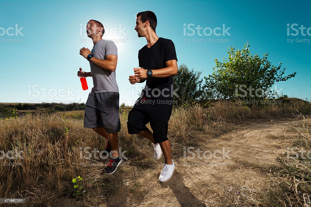 Two young man jogging in nature royalty-free stock photo