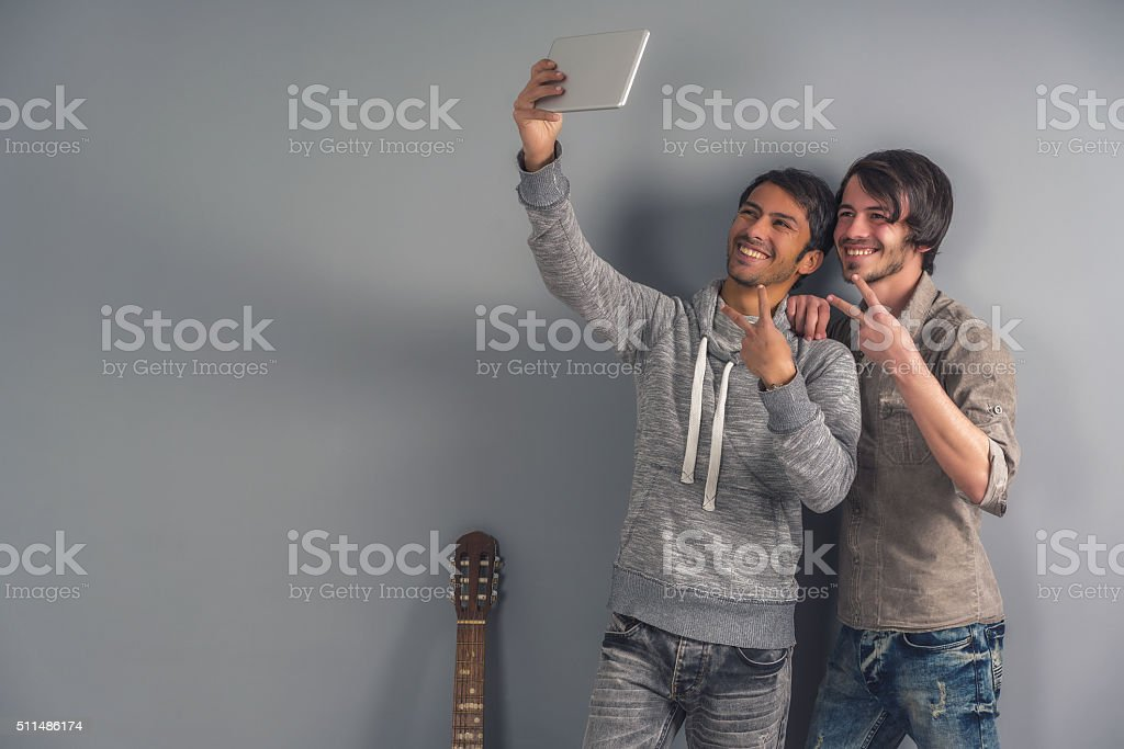 two young man selfie and peace sign stock photo