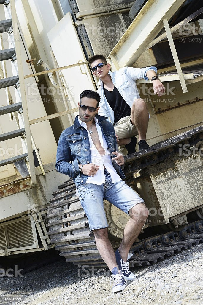 Two young man with jeans outfit royalty-free stock photo