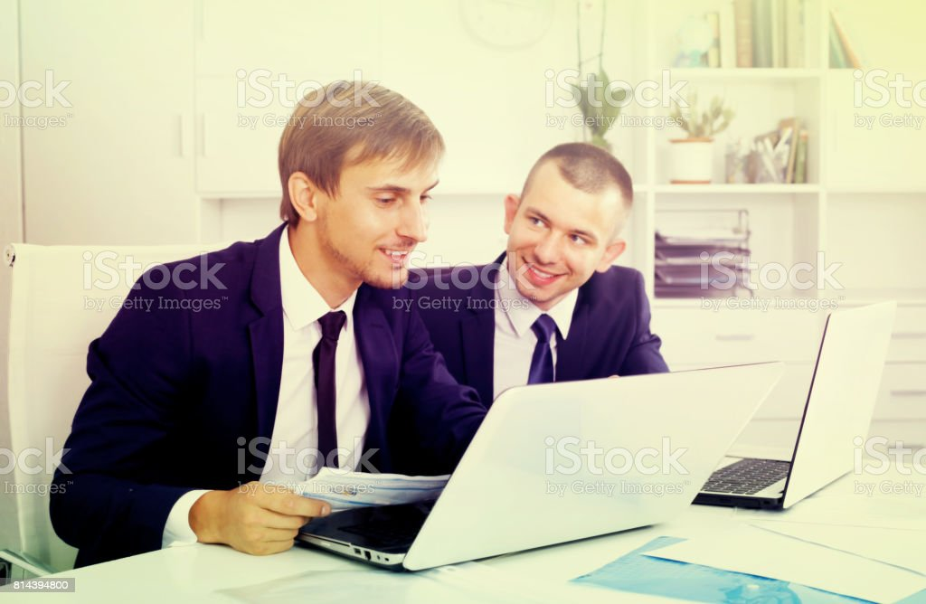 two young managers in office stock photo