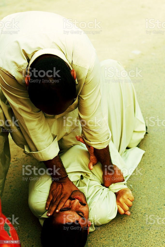 Two Young Men Fighting in Street stock photo