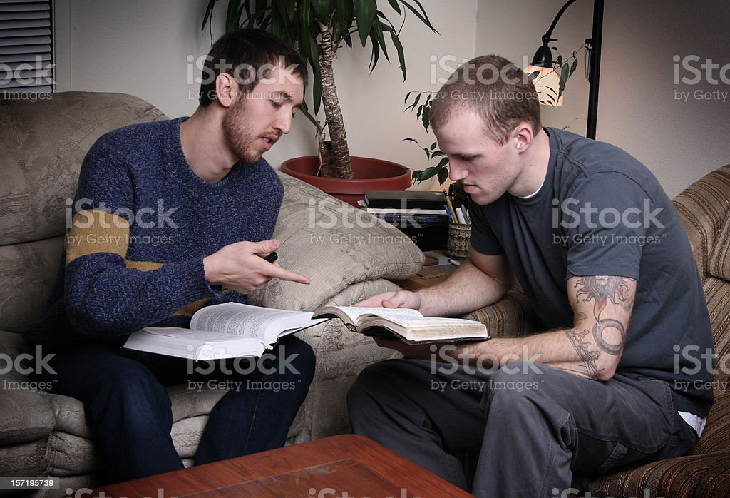 Two Young Men Having a Bible Study royalty-free stock photo