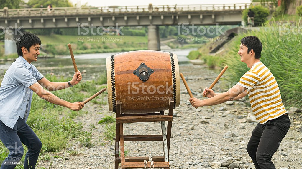 Two young men playing Japanese drum together stock photo