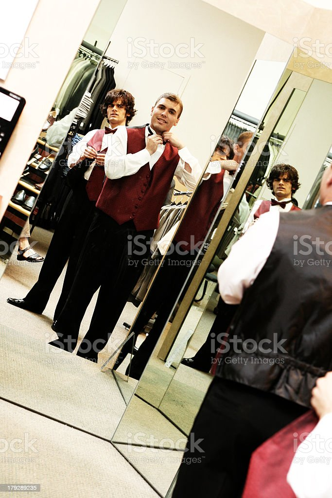 Two Young Men Trying on Tuxedos royalty-free stock photo