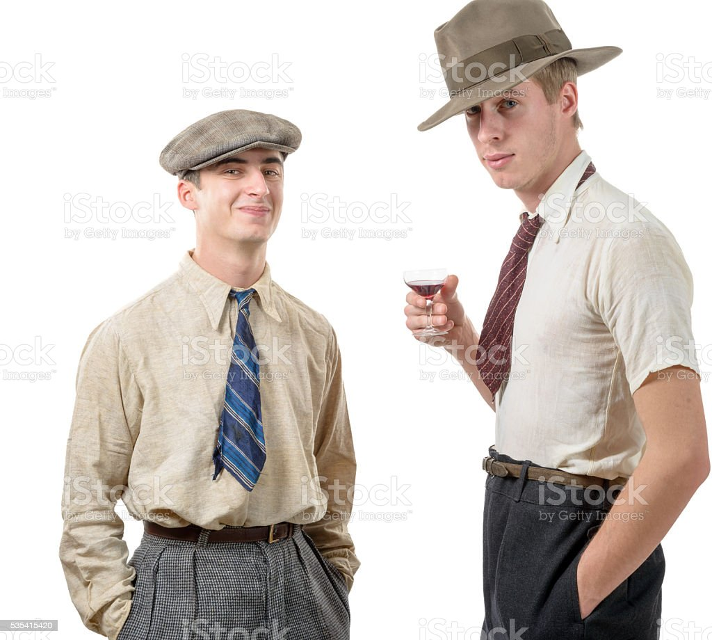 two young men with clothes and cap in 30s style. stock photo