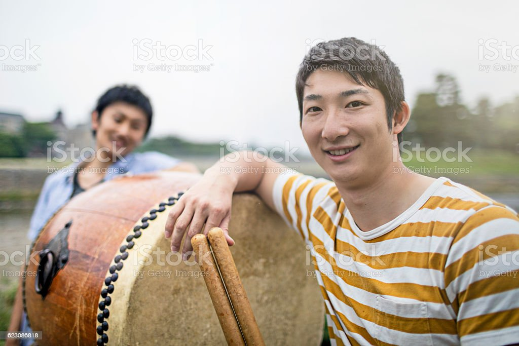Two young men with japanese taiko drum stock photo