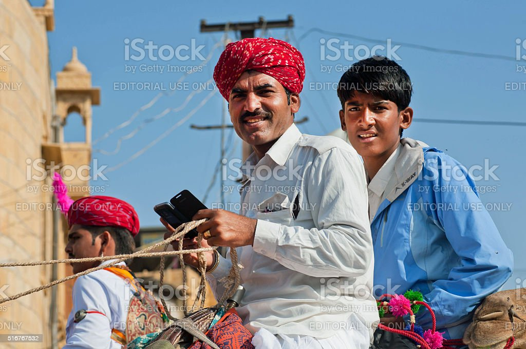 Two young men with mobile phone stock photo