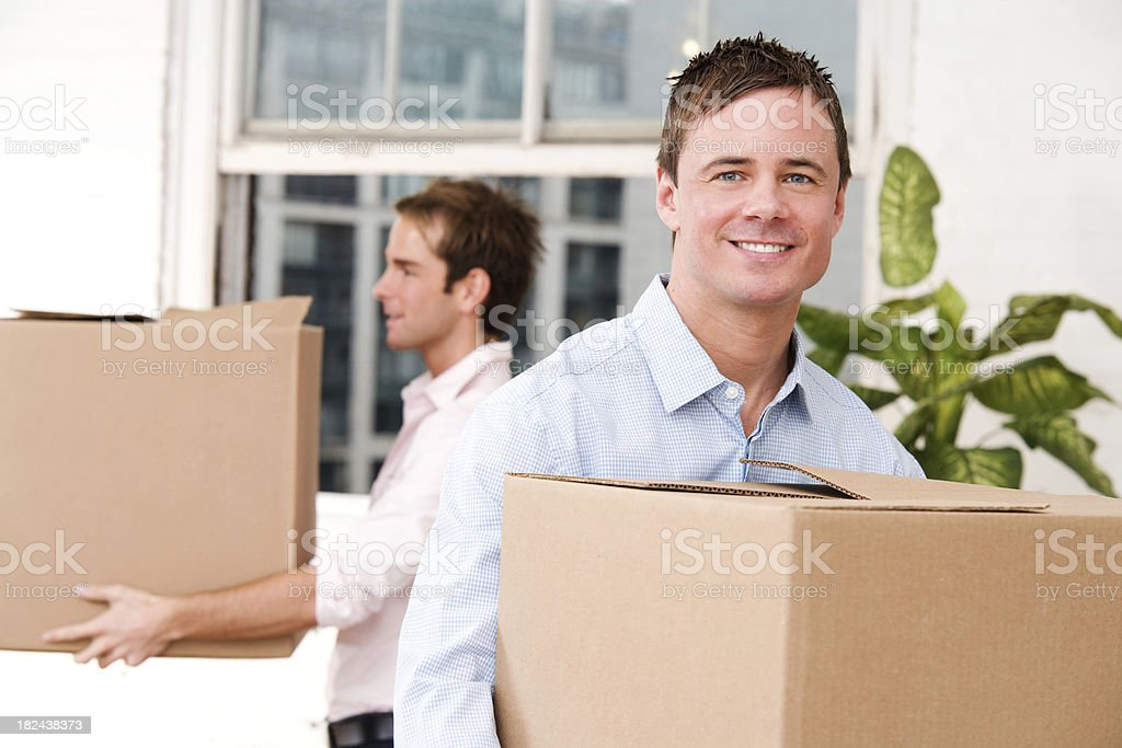 Two Young Men with Moving Boxes royalty-free stock photo