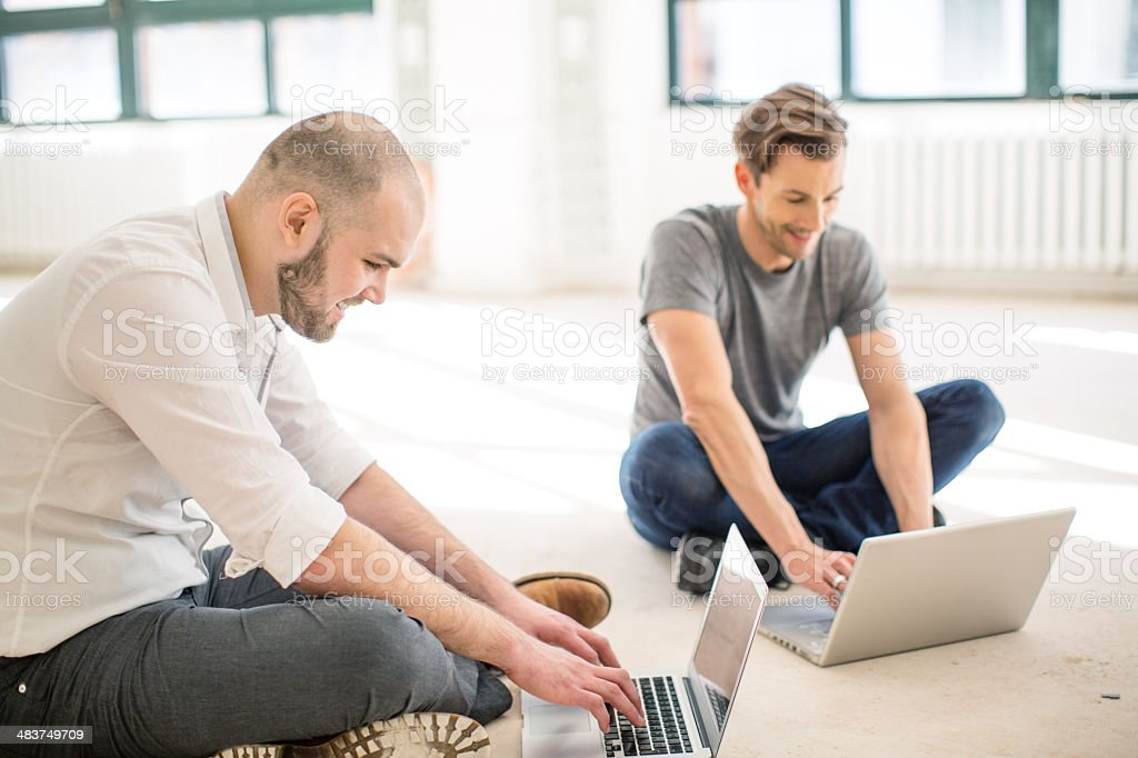 Two young men working on their start up royalty-free stock photo