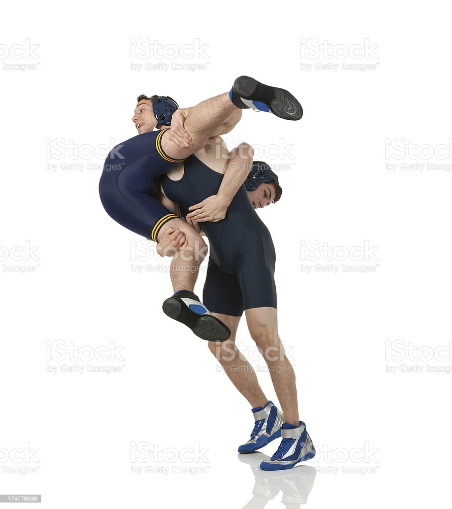 Two young men wrestling. stock photo