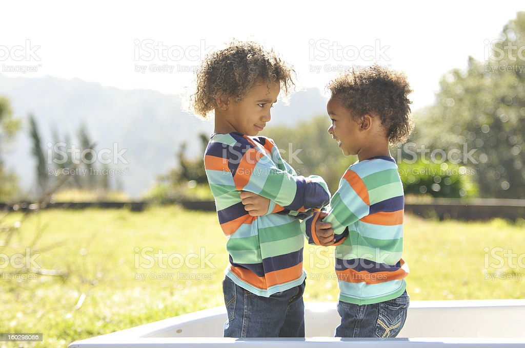 Two young mixed race children in bathtub royalty-free stock photo